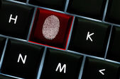 Onliine crime scene concept with the fingerprint left on a backl — Stock Photo