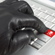 Stock Photo: Hacker concept with hand wearing black leather glove pressing en