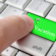 Stock Photo: Business concept male finger pressing vacation enter key on meta
