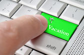 Business concept male finger pressing vacation enter key on meta — Stock Photo