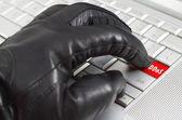 Online distributed denial services attack  concept with hand wea — Stock Photo