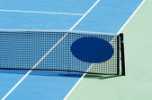 Outdoor tennis court focus on the net — Stock Photo