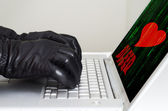 Heartbleed exploit concept with hands wearing black gloves — Stock Photo
