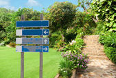 Blank signpost with four options against a natural stone landsca — Stockfoto