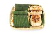 Vietnamese grilled banana cake covered with sweet sticky rice on — Stock Photo