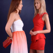 Girl handed the other girl's  gift box — Stockfoto
