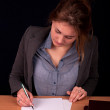Businesswoman  reviewing documents  — Lizenzfreies Foto