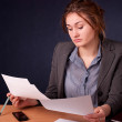 Businesswoman reviewing documents — Stock Photo