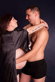 Pregnant couple hugging — Stock Photo