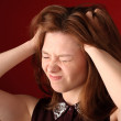 Stock Photo: Womhaving headache