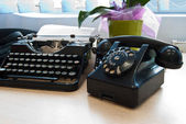 Vintage typewriter and phone — Stock Photo