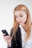 Businesswoman with smartphone — Stock Photo