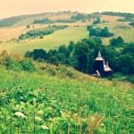 Rural landscape and church in Chyrowa — Stock Photo #51271971