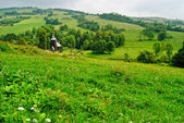 Rural landscape and church in Chyrowa — Stock Photo
