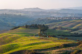 Road to Italian town in the Tuscan countryside. — Stock Photo