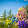 Little girl working with her mother in the garden — Stock Photo #47781339