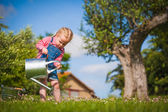 Little girl in the summer work's garden — Stock Photo