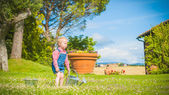 Little gardiner on the green grass in a summer day — Foto Stock