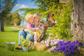 Woman and daughter doing garden work in summer sunny day — Stock Photo