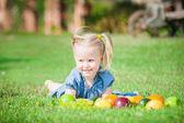 Girl eaten colorful fruits outside — Stock Photo