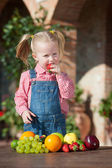 Girl eaten colorful fruits outside — Stok fotoğraf
