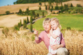 Family on holiday in Tuscany, mother and daughter are watching t — Stock Photo