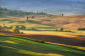 Beautiful sunrise over the Val d'Orcia in Tuscany, natural park  — Stockfoto