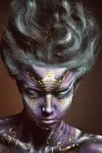 Painted beautiful woman — Stock Photo