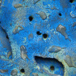 Texture of blue stone with holes — Stockfoto