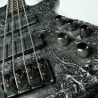 Black bass guitar with the original design — Stock Photo