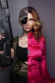 Photo of two different personalities -.beautiful woman and woman-soldier with a gun — Stock Photo
