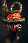 Painted mannequin Girl with metal headwear — Stock Photo