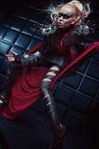 Blond woman in steel armor posing — Foto de Stock