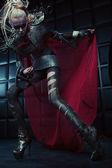 Blond woman in steel armor posing — Stok fotoğraf
