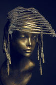 Mannequin girl  with headwear — Stock Photo