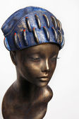 Mannequin girl in blue headwear — Stock Photo