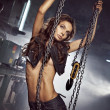 Beautiful girl with crane chains — Stock Photo #43767777