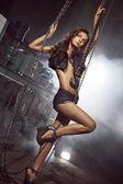 Beautiful girl with crane chains — Zdjęcie stockowe