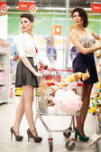 Beautiful girls shopping in the supermarket — Stock Photo