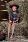 Girl in barn — Stock Photo