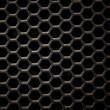 Stock Photo: Hexagonal, honey comb stainless steel mesh on black