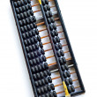 Chinese abacus with antique Chinese coins — Stockfoto