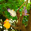 Stock Photo: Three bird sculpture on tree