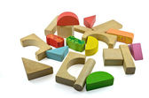 Wooden building blocks on white — Stock Photo