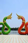 Red and Blue Serpent statue in temple Thailand — Stock Photo