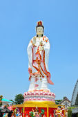 Guan Yin statue on blue sky background — Stock Photo