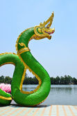 Green Serpent statue in temple Thailand — Stock Photo