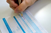 Business people writing the pen on deposit slip — Stock Photo