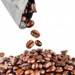 Roasted coffee beans pouring out from the pack. — Stock Photo