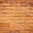 A brick wall in different natural orange tones — Stock Photo